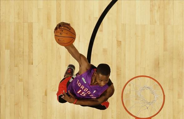 Feb 16, 2013; Houston, TX, USA; Toronto Raptors guard Terrence Ross (31) wearing a Vince Carter jersey as he performs a windmill dunk during the 2013 NBA All-Star slam dunk contest at the Toyota Center. Mandatory Credit: Eric Gay/AP via USA TODAY Sports