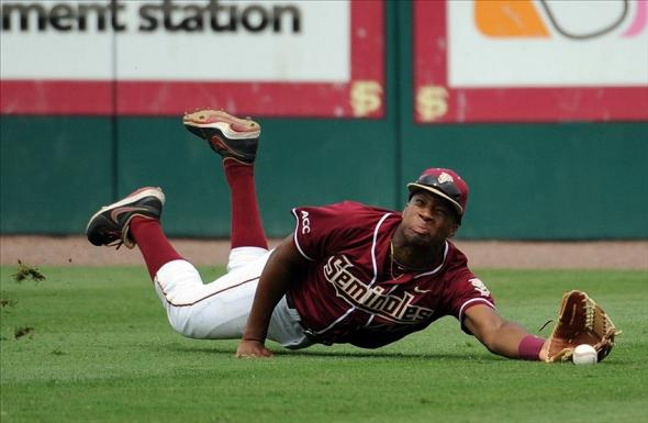 Jun 8, 2013; Tallahassee, FL, USA; Florida State Seminoles right fielder Jameis Winston (44) cannot make a catch for an out the game against the Indiana Hoosiers during the Tallahassee super regional of the 2013 NCAA baseball tournament at Dick Howser Stadium. Mandatory Credit: Melina Vastola-USA TODAY Sports