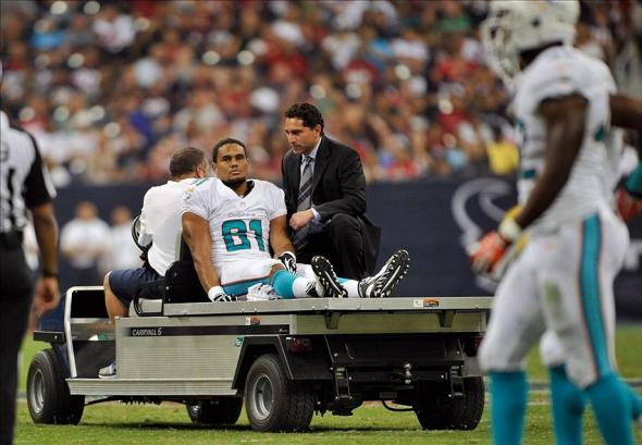 Aug 17, 2013; Houston, TX, USA; Miami Dolphins tight end Dustin Keller (81) is carted off the field with an injury during the first half against the Houston Texans at Reliant Stadium. Mandatory Credit: Jerome Miron-USA TODAY Sports