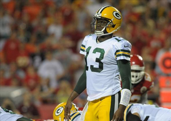 Aug 29, 2013; Kansas City, MO, USA; Green Bay Packers quarterback Vince Young (13) looks to the sidelines during the second half of the game against the Kansas City Chiefs at Arrowhead Stadium. The Chiefs won 30-8. Mandatory Credit: Denny Medley-USA TODAY Sports