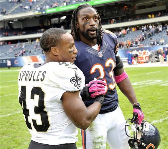 Oct 6, 2013; Chicago, IL, USA; Chicago Bears cornerback Charles Tillman (33) talks with New Orleans Saints running back Darren Sproles (43) after the game at Soldier Field. The Saints beat the Bears 26-18. Mandatory Credit: Rob Grabowski-USA TODAY Sports