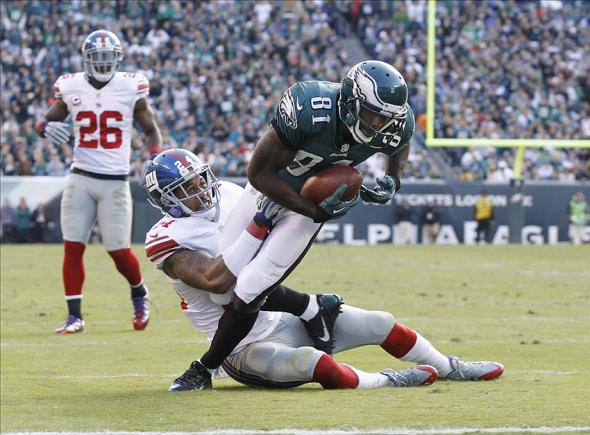 Oct 27, 2013; Philadelphia, PA, USA; New York Giants cornerback Terrell Thomas (24) tackles Philadelphia Eagles wide receiver Jason Avant (81) during the game at Lincoln Financial Field. Mandatory Credit: Chris Faytok/The Star-Ledger via USA Today Sports