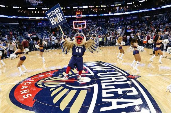 Nov 2, 2013; New Orleans, LA, USA; The New Orleans Pelicans mascot Pierre the Pelican and the Pelicans dance team celebrate following a win over the Charlotte Bobcats at New Orleans Arena. The Pelicans defeated the Bobcats 105-84. Mandatory Credit: Derick E. Hingle-USA TODAY Sports
