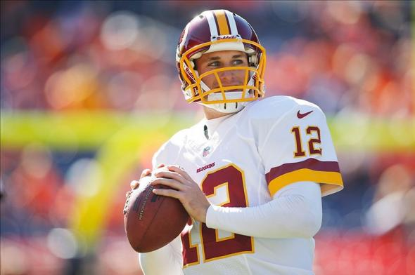 Oct 27, 2013; Denver, CO, USA; Washington Redskins quarterback Kirk Cousins (12) before the game against the Denver Broncos at Sports Authority Field at Mile High. Mandatory Credit: Chris Humphreys-USA TODAY Sports