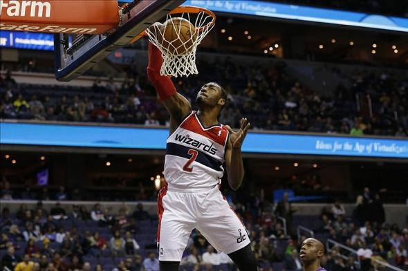Nov 26, 2013; Washington, DC, USA; Washington Wizards point guard John Wall (2) dunks the ball against the Los Angeles Lakers in the first quarter at Verizon Center. Mandatory Credit: Geoff Burke-USA TODAY Sports