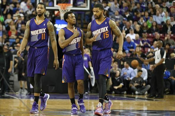 Nov 19, 2013; Sacramento, CA, USA; Phoenix Suns power forward Markieff Morris (11), point guard Ish Smith (3) and power forward Marcus Morris (15) walk to the bench for a timeout against the Sacramento Kings during the first quarter at Sleep Train Arena. Mandatory Credit: Kelley L Cox-USA TODAY Sports