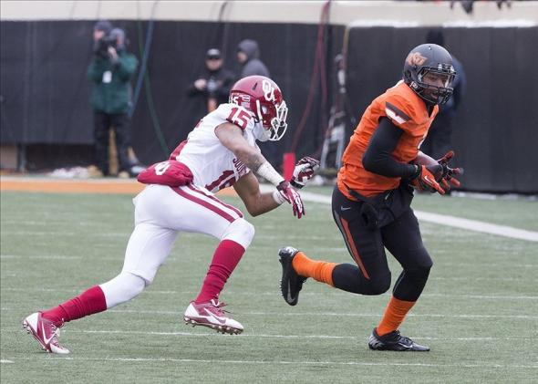 Dec 7, 2013; Stillwater, OK, USA; Oklahoma State Cowboys wide receiver Brandon Sheperd (7) makes the catch during the third quarter against Oklahoma Sooners defensive back Trey Franks (7) at Boone Pickens Stadium. Mandatory Credit: Richard Rowe-USA TODAY Sports