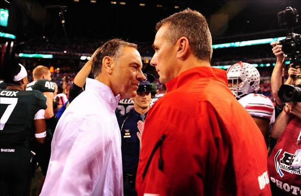 Dec 7, 2013; Indianapolis, IN, USA; Michigan State Spartans head coach Mark Dantonio shakes hands with Ohio State Buckeyes head coach Urban Meyer after being after the 2013 Big 10 Championship game at Lucas Oil Stadium. Michigan State Spartans derated Ohio State Buckeyes 34-24. Mandatory Credit: Andrew Weber-USA TODAY Sports