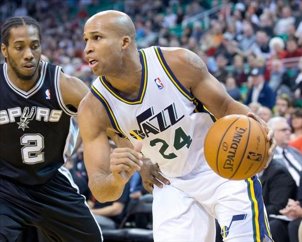 Dec 14, 2013; Salt Lake City, UT, USA; Utah Jazz small forward Richard Jefferson (24) drives in front of San Antonio Spurs small forward Kawhi Leonard (2) during the first quarter at EnergySolutions Arena. Mandatory Credit: Russ Isabella-USA TODAY Sports