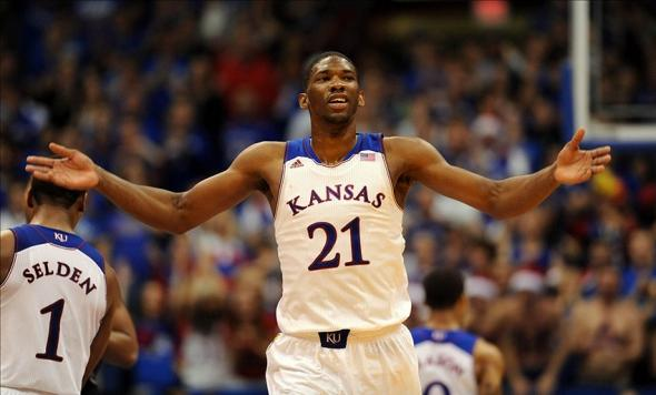 Dec 21, 2013; Lawrence, KS, USA; Kansas Jayhawks center Joel Embiid (21) celebrates after scoring during the second half of the game against the Georgetown Hoyas at Allen Fieldhouse. Kansas won 86-64. Mandatory Credit: Denny Medley-USA TODAY Sports