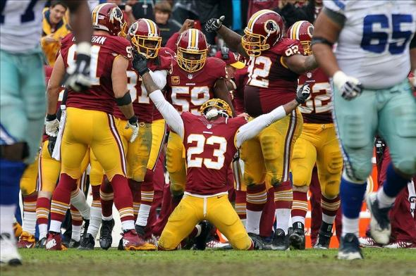 Dec 22, 2013; Landover, MD, USA; Washington Redskins cornerback DeAngelo Hall (23) celebrates after an interception against the Dallas Cowboys in the third quarter at FedEx Field. The Cowboys won 24-23. Mandatory Credit: Geoff Burke-USA TODAY Sports