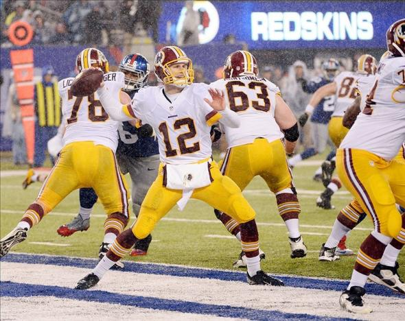 Dec 29, 2013; East Rutherford, NJ, USA; Washington Redskins quarterback Kirk Cousins (12) throws a pass against the New York Giants during the game at MetLife Stadium. Mandatory Credit: Robert Deutsch-USA TODAY Sports