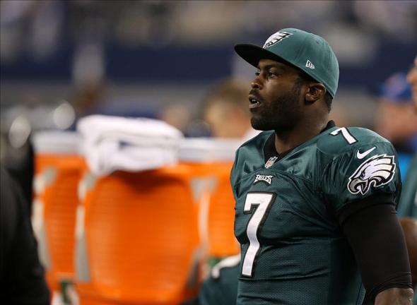 Dec 29, 2013; Arlington, TX, USA; Philadelphia Eagles quarterback Michael Vick (7) on the bench during the game against the Dallas Cowboys at AT&T Stadium. Mandatory Credit: Matthew Emmons-USA TODAY Sports