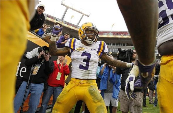 Jan 1, 2014; Tampa, Fl, USA; LSU Tigers wide receiver Odell Beckham (3) reacts and celebrates after they scored a touchdown against the Iowa Hawkeyes during the second half at Raymond James Stadium. LSU Tigers defeated the Iowa Hawkeyes 21-14. Mandatory Credit: Kim Klement-USA TODAY Sports
