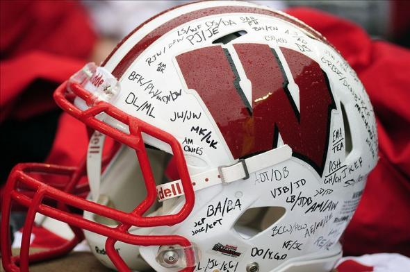Jan 1, 2014; Orlando, FL, USA; An autographed Wisconsin Badgers helmet sits in the equipment trunk before Wisconsin plays the South Carolina Gamecocks in the Capital One Bowl at Florida Citrus Bowl. Mandatory Credit: David Manning-USA TODAY Sports