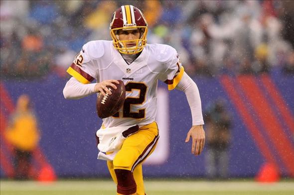 Dec 29, 2013; East Rutherford, NJ, USA; Washington Redskins quarterback Kirk Cousins (12) runs with the ball during a game against the New York Giants at MetLife Stadium. The Giants defeated the Redskins 20-6. Mandatory Credit: Brad Penner-USA TODAY Sports