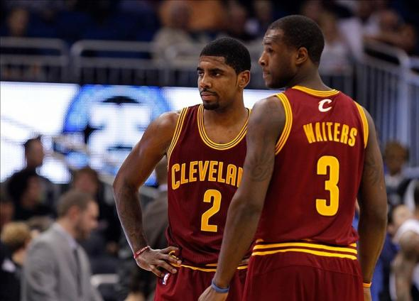 Dec 13, 2013; Orlando, FL, USA; Cleveland Cavaliers point guard Kyrie Irving (2) and shooting guard Dion Waiters (3) against the Orlando Magic during the first quarter at Amway Center. Mandatory Credit: Kim Klement-USA TODAY Sports
