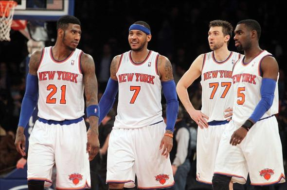 Jan 13, 2014; New York, NY, USA; New York Knicks shooting guard Iman Shumpert (21) and Knicks small forward Carmelo Anthony (7) and Knicks power forward Andrea Bargnani (77) and Knicks shooting guard Tim Hardaway Jr. (5) take the court for the final 0.2 seconds of the game during overtime of a game against the Phoenix Suns at Madison Square Garden. The Knicks defeated the Suns 98-96 in overtime. Mandatory Credit: Brad Penner-USA TODAY Sports