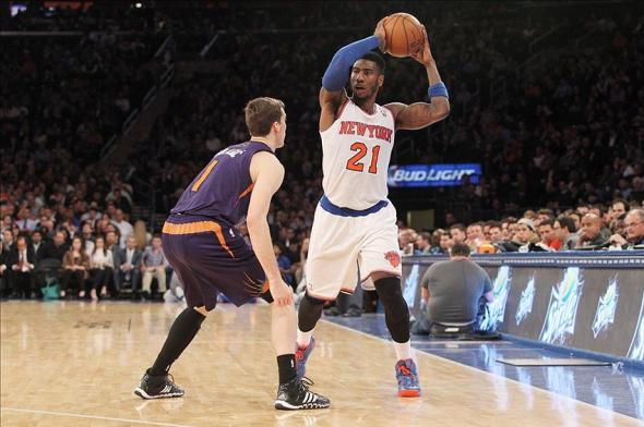 Jan 13, 2014; New York, NY, USA; New York Knicks shooting guard Iman Shumpert (21) controls the ball against Phoenix Suns shooting guard Goran Dragic (1) during the third quarter of a game at Madison Square Garden. The Knicks defeated the Suns 98-96 in overtime. Mandatory Credit: Brad Penner-USA TODAY Sports