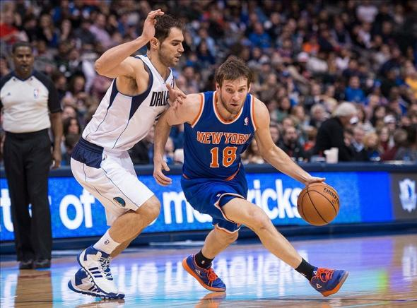 Jan 5, 2014; Dallas, TX, USA; Dallas Mavericks point guard Jose Calderon (8) guards New York Knicks point guard Beno Udrih (18) during the game at the American Airlines Center. The Knicks defeated the Mavericks 92-80. Mandatory Credit: Jerome Miron-USA TODAY Sports