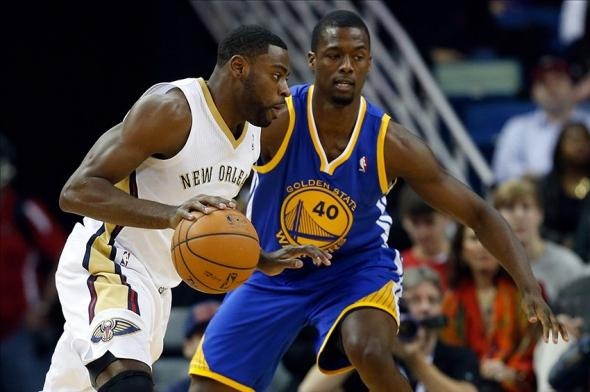 Jan 18, 2014; New Orleans, LA, USA; New Orleans Pelicans point guard Tyreke Evans (1) drives past Golden State Warriors small forward Harrison Barnes (40) during the first half of a game at the New Orleans Arena. Mandatory Credit: Derick E. Hingle-USA TODAY Sports