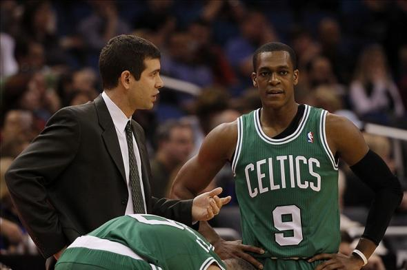 Jan 19, 2014; Orlando, FL, USA; Boston Celtics head coach Brad Stevens talks with point guard Rajon Rondo (9) against the Orlando Magic during the second half at Amway Center. Orlando Magic won 93-91. Mandatory Credit: Kim Klement-USA TODAY Sports