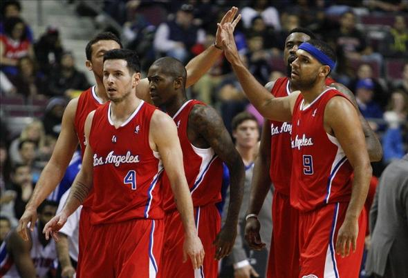 Jan 20, 2014; Auburn Hills, MI, USA; Los Angeles Clippers shooting guard J.J. Redick (4) shooting guard Jamal Crawford (middle) small forward Jared Dudley (9) center DeAndre Jordan (back right) and small forward Hedo Turkoglu (back left) celebrate during the fourth quarter against the Detroit Pistons at The Palace of Auburn Hills. Clippers beat the Pistons 112-103. Mandatory Credit: Raj Mehta-USA TODAY Sports