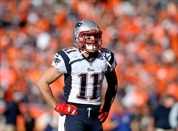 January 19, 2014; Denver, CO, USA; New England Patriots wide receiver Julian Edelman (11) against the Denver Broncos in the 2013 AFC Championship football game at Sports Authority Field at Mile High. Mandatory Credit: Mark J. Rebilas-USA TODAY Sports
