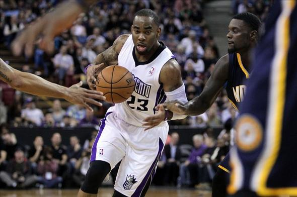 Jan 24, 2014; Sacramento, CA, USA; Sacramento Kings guard Marcus Thornton (23) drives the lane in front of Indiana Pacers defenders in the first half of their NBA basketball game at Sleep Train Arena. Mandatory Credit: Lance Iversen-USA TODAY Sports