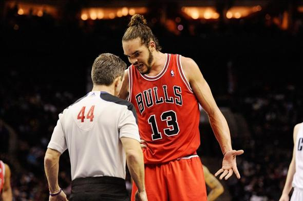 Jan 25, 2014; Charlotte, NC, USA; Chicago Bulls center Joakim Noah (13) complains to referee Eli Roe (44) during the second half of the game against the Charlotte Bobcats at Time Warner Cable Arena. Bulls win 89-87. Mandatory Credit: Sam Sharpe-USA TODAY Sports