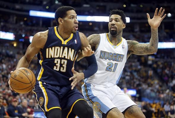 Jan 25, 2014; Denver, CO, USA; Indiana Pacers forward Danny Granger (33) drives to the basket past Denver Nuggets forward Wilson Chandler (21) during the first half at Pepsi Center. Mandatory Credit: Chris Humphreys-USA TODAY Sports