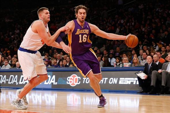 Jan 26, 2014; New York, NY, USA; Los Angeles Lakers center Pau Gasol (16) dribbles the ball New York Knicks center Cole Aldrich (45) during the first quarter at Madison Square Garden. Mandatory Credit: Anthony Gruppuso-USA TODAY Sports