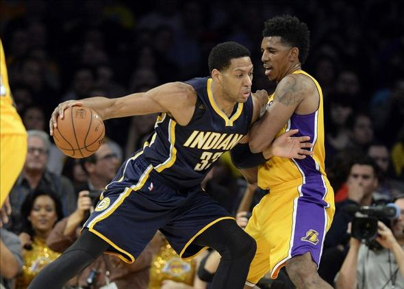 Jan 28, 2014; Los Angeles, CA, USA; Los Angeles Lakers small forward Nick Young (0) defends against Indiana Pacers small forward Danny Granger (33) during the first half at Staples Center. Mandatory Credit: Richard Mackson-USA TODAY Sports