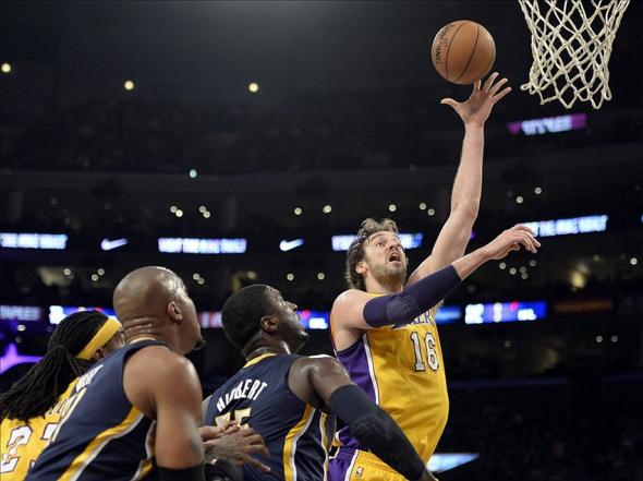Jan 28, 2014; Los Angeles, CA, USA; Los Angeles Lakers center Pau Gasol (16) shoots over Indiana Pacers center Roy Hibbert (55) during the first half at Staples Center. Mandatory Credit: Richard Mackson-USA TODAY Sports