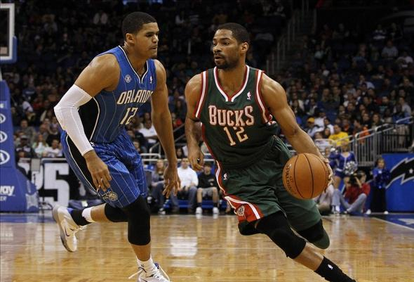 Jan 31, 2014; Orlando, FL, USA; Milwaukee Bucks shooting guard Gary Neal (12) dribbles the ball as Orlando Magic small forward Tobias Harris (12) defends during the second quarter at Amway Center. Mandatory Credit: Kim Klement-USA TODAY Sports