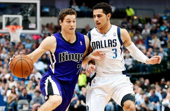 Jan 31, 2014; Dallas, TX, USA; Sacramento Kings point guard Jimmer Fredette (7) dribbles as Dallas Mavericks point guard Shane Larkin (3) defends during the game at American Airlines Center. Mandatory Credit: Kevin Jairaj-USA TODAY Sports