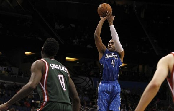 Jan 31, 2014; Orlando, FL, USA; Orlando Magic shooting guard Arron Afflalo (4) shoots the ball against the Milwaukee Bucks during the second half at Amway Center. Orlando Magic won 113-102. Mandatory Credit: Kim Klement-USA TODAY Sports