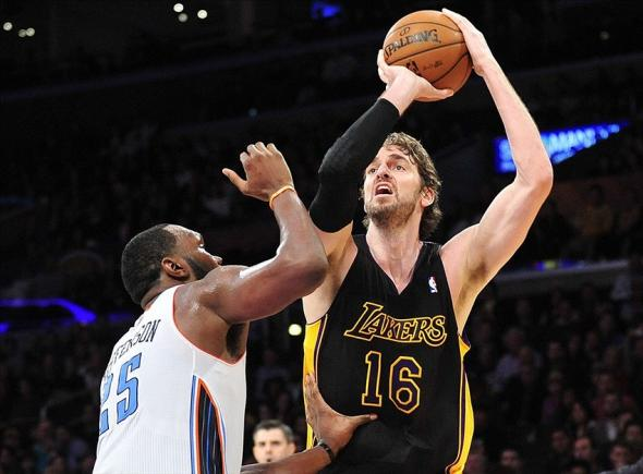 January 31, 2014; Los Angeles, CA, USA; Los Angeles Lakers center Pau Gasol (16) shoots a basket against the defense of Charlotte Bobcats center Al Jefferson (25) during the second half at Staples Center. Mandatory Credit: Gary A. Vasquez-USA TODAY Sports