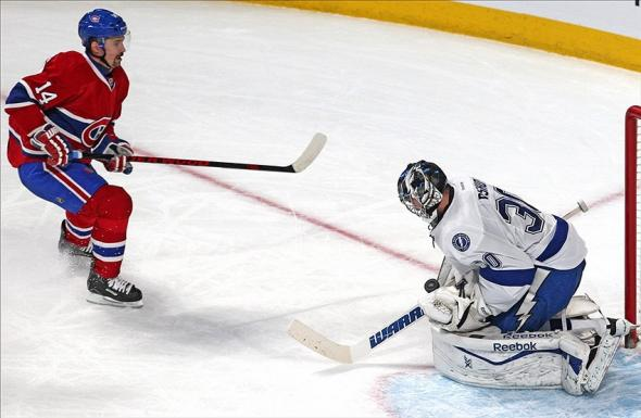 Feb 1, 2014; Montreal, Quebec, CAN; Tampa Bay Lightning goalie Ben Bishop (30) makes a save against Montreal Canadiens center Tomas Plekanec (14) during the second period at Bell Centre. Mandatory Credit: Jean-Yves Ahern-USA TODAY Sports