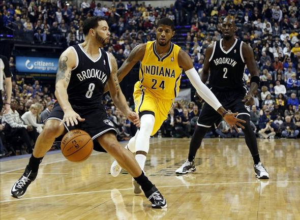 Feb 1, 2014; Indianapolis, IN, USA; Brooklyn Nets guard Deron Williams (8) drives to the basket against Indiana Pacers forward Paul George (24) at Bankers Life Fieldhouse. Mandatory Credit: Brian Spurlock-USA TODAY Sports