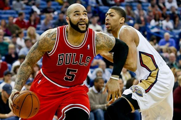 Feb 1, 2014; New Orleans, LA, USA; Chicago Bulls power forward Carlos Boozer (5) drives past New Orleans Pelicans power forward Anthony Davis (23) during the first quarter of a game at the New Orleans Arena. Mandatory Credit: Derick E. Hingle-USA TODAY Sports