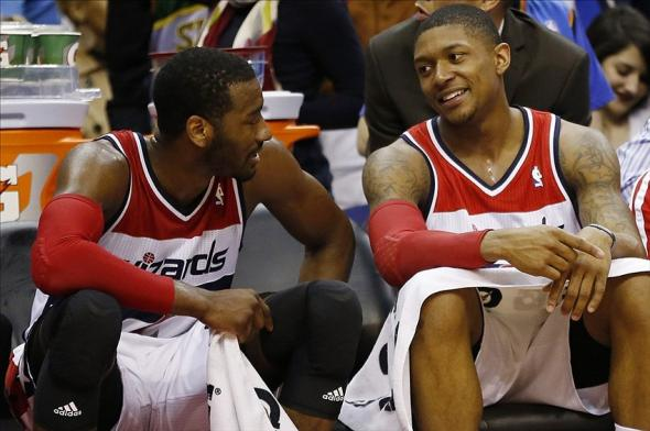 Feb 1, 2014; Washington, DC, USA; Washington Wizards point guard John Wall (2) smiles on the bench with Wizards shooting guard Bradley Beal (3) against the Oklahoma City Thunder in the fourth quarter at Verizon Center. The Wizards won 96-81. Mandatory Credit: Geoff Burke-USA TODAY Sports