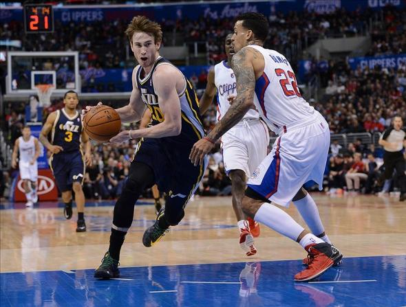 Feb 1, 2014; Los Angeles, CA, USA; Los Angeles Clippers small forward Matt Barnes (22) defends Utah Jazz shooting guard Gordon Hayward (20) in the first half of the game at Staples Center. Mandatory Credit: Jayne Kamin-Oncea-USA TODAY Sports