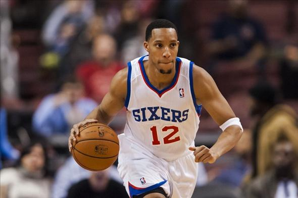 Jan 31, 2014; Philadelphia, PA, USA; Philadelphia 76ers guard Evan Turner (12) brings the ball up court during the first quarter against the Atlanta Hawks at the Wells Fargo Center. The Hawks defeated the Sixers 125-99. Mandatory Credit: Howard Smith-USA TODAY Sports