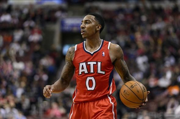 Jan 31, 2014; Philadelphia, PA, USA; Atlanta Hawks guard Jeff Teague (0) during the third quarter against the Philadelphia 76ers at the Wells Fargo Center. The Hawks defeated the Sixers 125-99. Mandatory Credit: Howard Smith-USA TODAY Sports