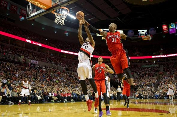 Feb 1, 2014; Portland, OR, USA; Toronto Raptors small forward Terrence Ross (31) fouls Portland Trail Blazers power forward Thomas Robinson (41) in the second half at Moda Center. Mandatory Credit: Jaime Valdez-USA TODAY Sports