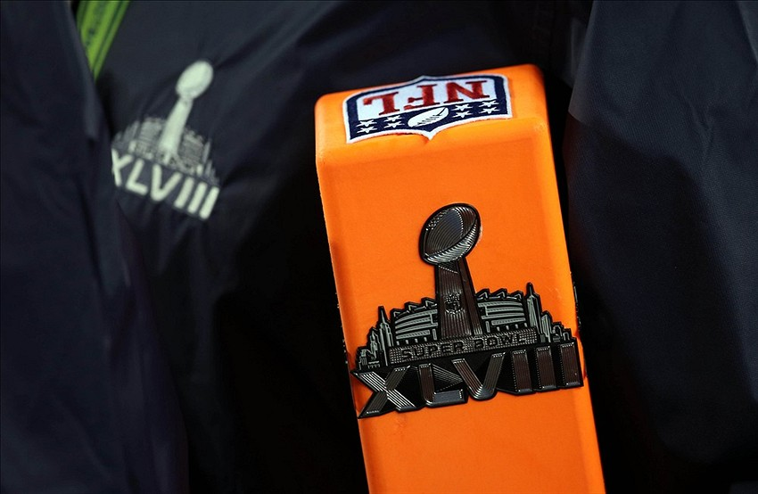 Feb 2, 2014; East Rutherford, NJ, USA; An official carries an end zone pylon with the Super Bowl XLVIII logo before the game between the Seattle Seahawks and the Denver Broncos at MetLife Stadium. Mandatory Credit: Joe Camporeale-USA TODAY Sports