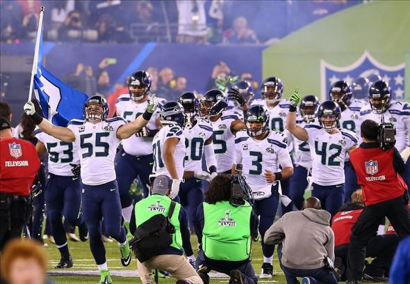 Feb 2, 2014; East Rutherford, NJ, USA; Seattle Seahawks linebacker Heath Farwell (55) leads in the Seahawks to Super Bowl XLVIII at MetLife Stadium. Mandatory Credit: Ed Mulholland-USA TODAY Sports