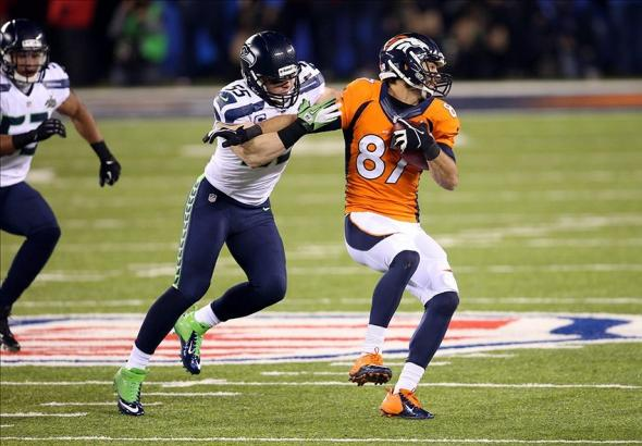 Feb 2, 2014; East Rutherford, NJ, USA; Denver Broncos wide receiver Eric Decker (87) is tackled by Seattle Seahawks linebacker Heath Farwell (55) in the third quarter in Super Bowl XLVIII at MetLife Stadium. Mandatory Credit: Joe Camporeale-USA TODAY Sports