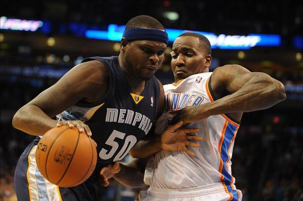 Feb 3, 2014; Oklahoma City, OK, USA; Memphis Grizzlies power forward Zach Randolph (50) handles the ball against Oklahoma City Thunder center Kendrick Perkins (5) during the first quarter at Chesapeake Energy Arena. Mandatory Credit: Mark D. Smith-USA TODAY Sports